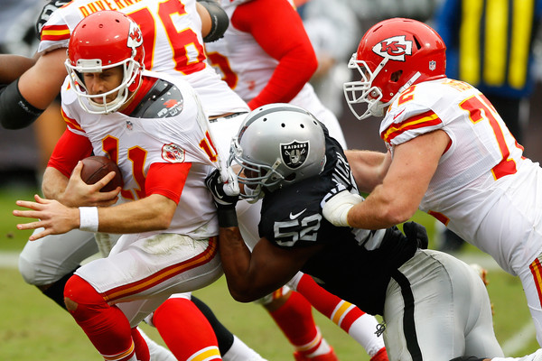 Alex Smith #11 of the Kansas City Chiefs is sacked by Khalil Mack #52 of the Oakland Raiders during their NFL game at O.co Coliseum on December 6, 2015 in Oakland, California. (Dec. 5, 2015 - Source: Jason O. Watson/Getty Images North America)
