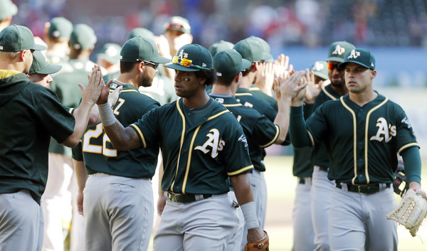 The Oakland Athletics celebrate a 5-2 win after a baseball game against the Texas Rangers |Sept. 30, 2017 - Source: Brandon Wade/Getty Images North America|