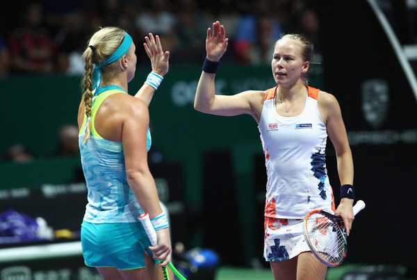 Bertens and Larsson celebrates winning a point | Photo: Clive Brunskill/Getty Images AsiaPac
