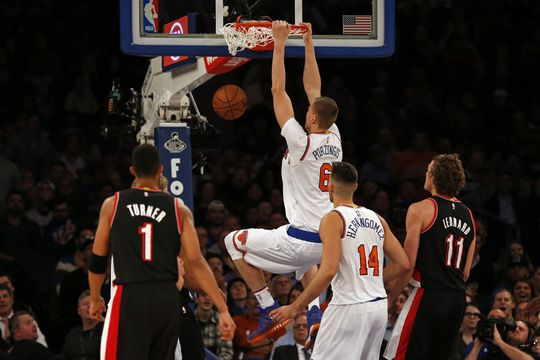 New York Knicks Forward Kristaps Porzingis does a slam dunk. Photo Courtesy of Adam Hunger-USA TODAY Sports.