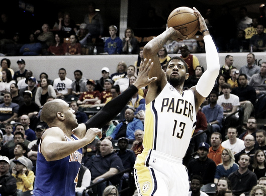 Indiana Pacers Foward Paul George shoots over New York Knicks Guard Arron Afflalo. Brian Spurlock-USA TODAY Sports
