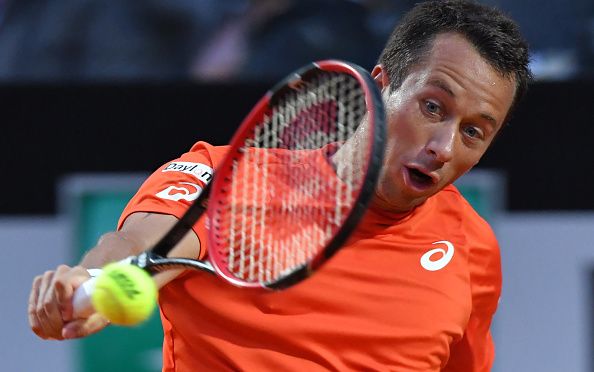 Philipp Kohlschreiber hits a backhand during the match. Photo: Tiziana Fabi/AFP/Getty Images