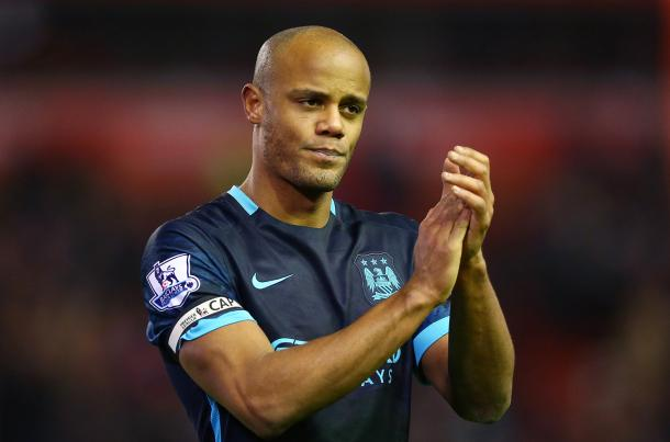 Kompany looked dejected following a poor performance against Liverpool. (Source: The Sun)
