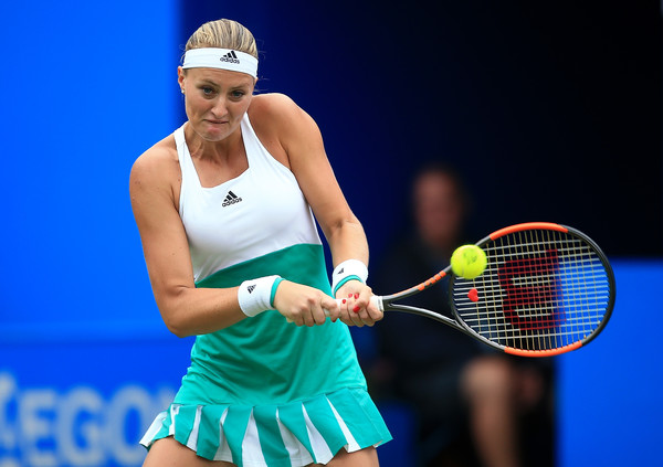 Kristina Mladenovic hits a backhand | Photo: Ben Hoskins/Getty Images Europe