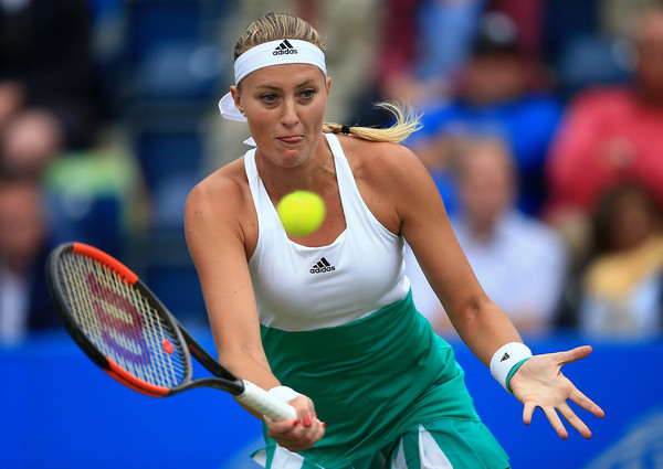 Kristina Mladenovic hits a volley | Photo: Ben Hoskins/Getty Images Europe