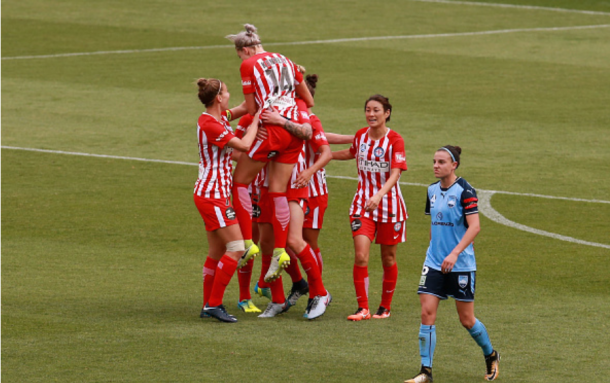 Larissa Crummer is lifted by her Melbourne City teammates after giving her team a 2-1 lead. They would go on to lose 3-2. | Photo: Jason McCawley - Getty Images