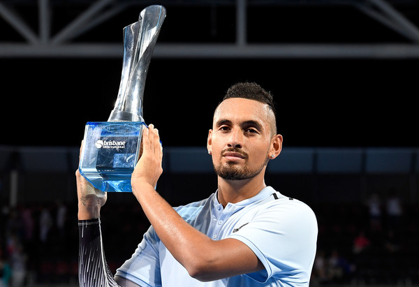 Nick Kyrgios hoists the trophy in Brisbane. Photo: Bradley Kanaris/Getty Images