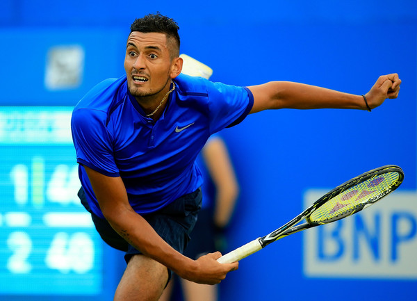 Nick Kyrgios serves during his first round loss in London. Photo: Ben Hoskins/Getty Images