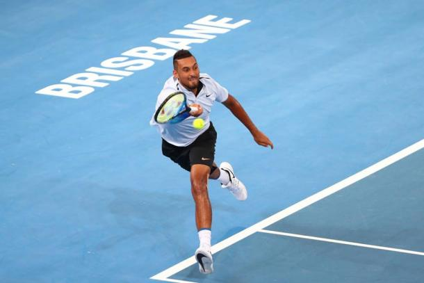 Nick Kyrgios chases down a forehand during his second round win. Photo: Brisbane International