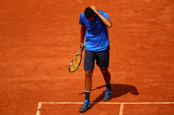 Kyrgios walks off the court disappointed during his third round loss at the French Open. Photo: Clive Brunskill/Getty Images