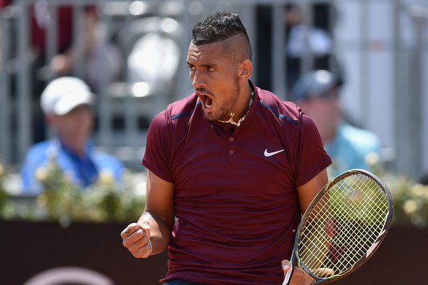 Kyrgios celebrates during his first round win in Rome. Photo: Dennis Grombkowski/Getty Images
