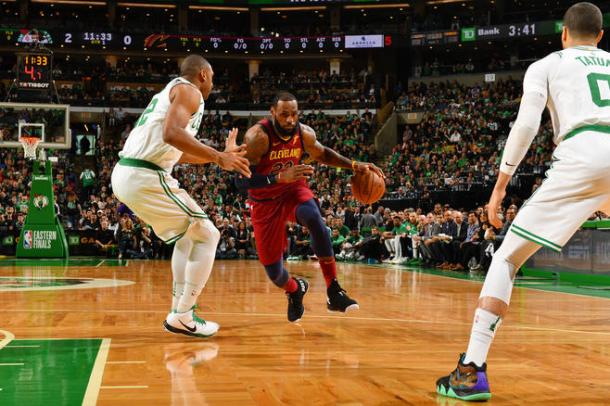 LeBron James drives into the paint against Al Horford. Photo: Jesse D. Garrabrant/NBAE via Getty Images