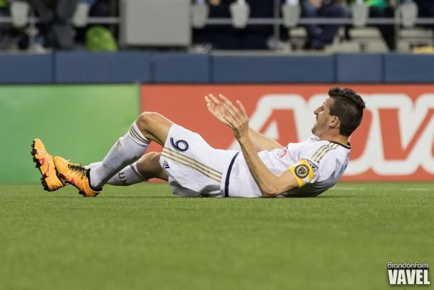 Sebastian Le Toux falls to the ground after scoring a goal against the Seattle Sounders | Brandon Farris - VAVEL USA