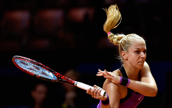Sabine Lisicki following through on a backhand. | Photo: Dennis Grombkowski