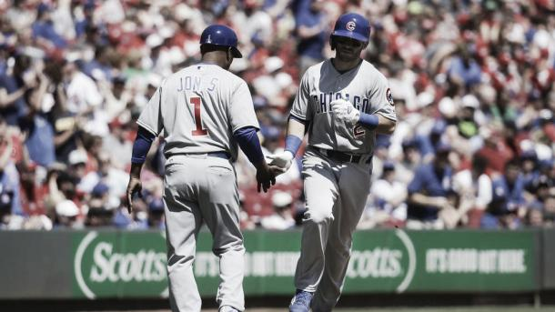 Chicago Cubs' Tommy La Stella (2) celebrates with third base coach Gary Jones (1) after hitting a solo home run off Cincinnati Reds relief pitcher Drew Hayes in the sixth inning of a baseball game, Sunday, April 24, 2016, in Cincinnati. The Cubs won a shutout 9-0. (AP Photo/John Minchillo)