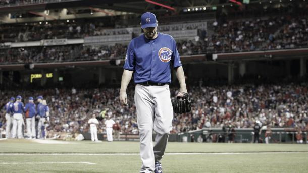 John Lackey walks to the dugout after being pulled from the game on Saturday in Cincinnati (AP)