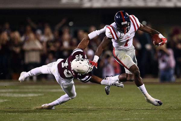 Laquon Treadwell #1 of the Mississippi Rebels avoids a tackle by J.T. Gray #45 of the Mississippi State Bulldogs during the second quarter of a game at Davis Wade Stadium on November 28, 2015 in Starkville, Mississippi. (Nov. 27, 2015 - Source: Stacy Revere/Getty Images North America)