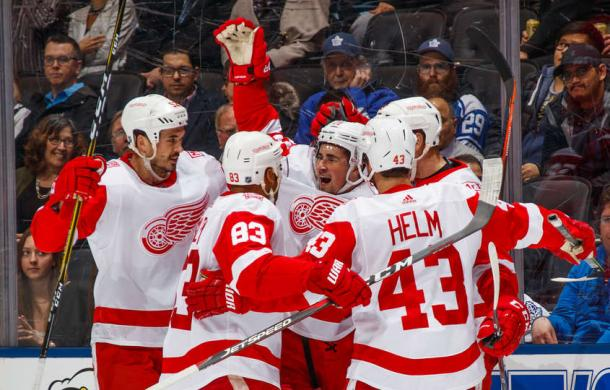 The Red Wings celebrate after Dylan Larkin (centre) tied the game at one in the second period. Photo: Mark Blinch/NHLI via Getty Images