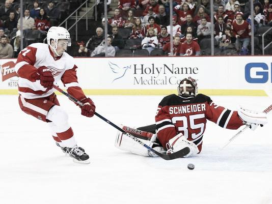Dylan Larkin scores on Devils goalie Cory Schneider (Photo: Ed Mulholland, USA TODAY Sports