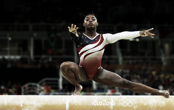  Simone Biles performing a wolf turn on balance beam. Photo Credit: Lars Baron of Getty South AmericaSimone Biles performing a wolf turn on balance beam. Photo Credit: Lars Baron of Getty South America Click and drag to move 