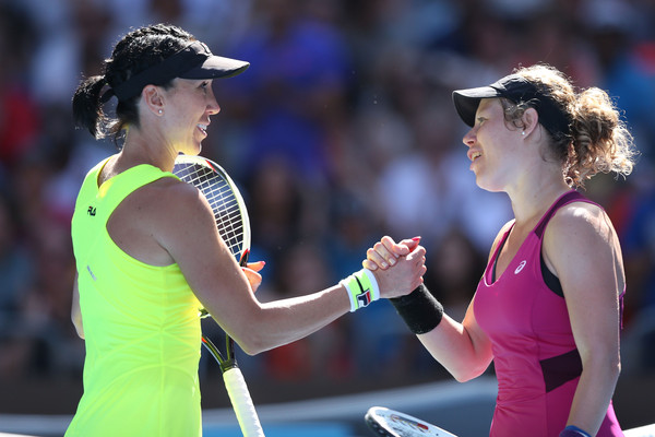 Jelena Jankovic and Laura Siegemund embrace each other at the net after their second round at the Australian Open in January. Photo credit : Michael Dodge / Getty Images.