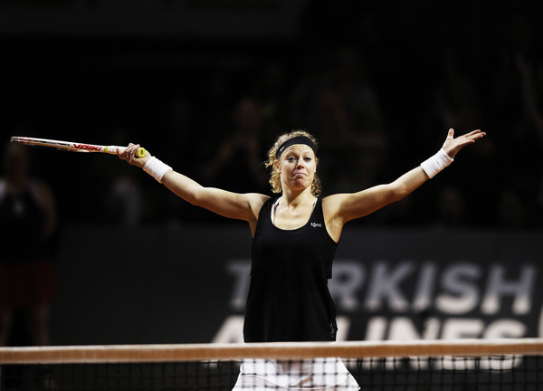 Laura Siegemund raises her arms in celebration after defeating Simona Halep in the semifinals of the 2017 Porsche Tennis Grand Prix. | Photo: Adam Pretty/Bongarts