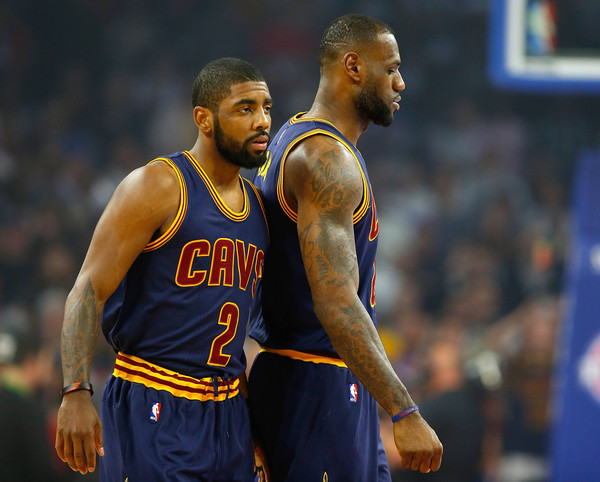 Kyrie Irving #2 and LeBron James #23 of the Cleveland Cavaliers prepare for tip off against the Detroit Pistons in game four of the NBA Eastern Conference quarterfinals during the 2016 NBA Playoffs. |April 23, 2016 - Source: Gregory Shamus/Getty Images North America|