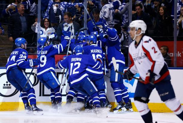The Toronto Maple Leafs pile on after Tyler Bozak's game-winning goal. Photo: Kevin Sousa/Getty Images