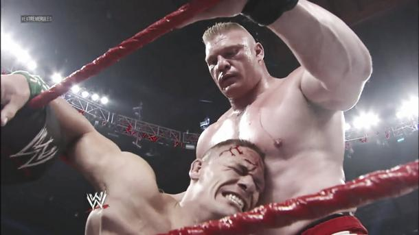 Lesnar stands over Cena in a sinister fashion (image: thegoodworker.blogspot,com)