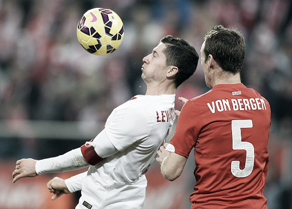 Above: Robert Lewandowski battling with Steven von Bergen in Poland's 2-2 draw with Switzerland | Photo: AFP/Janek Skazynski