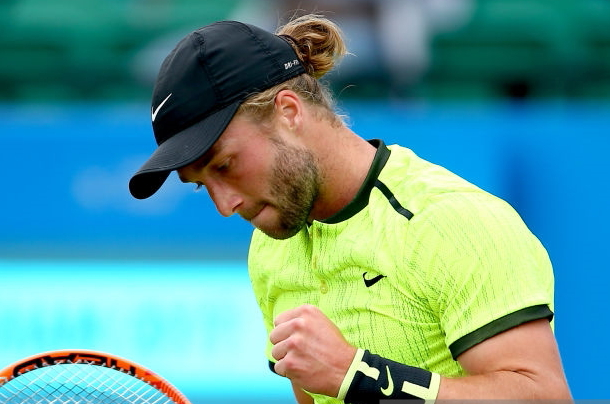 Photo: Jordan Mansfield/Getty Images-Liam Broady excited at securing the second set.