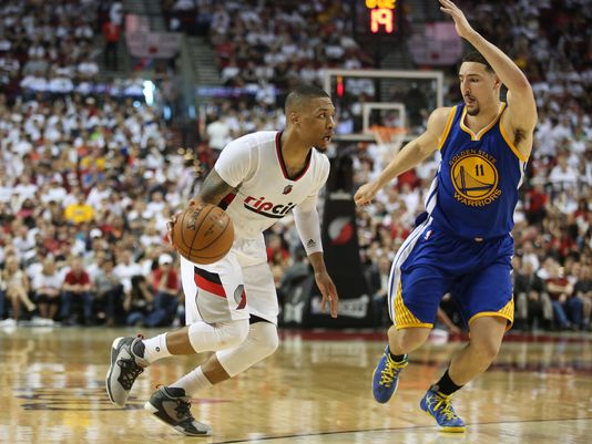 Portland Trail Blazers guard Damian Lillard (0) dribbles past Golden State Warriors guard Klay Thompson (11) in Game 3. (Photo: Jaime Valdez-USA TODAY)