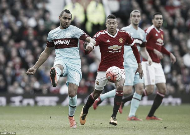 Above: Jesse Lingard battling with Dimitri Payet in Manchester United's 1-1 draw with West Ham United photo:Reuters