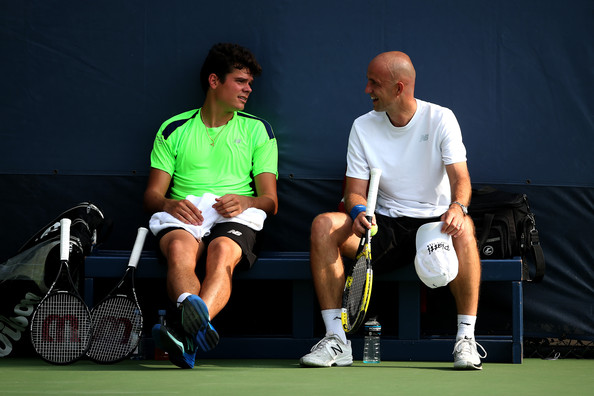 Ivan Ljubicic (right) talks to Milos Raonic during a practice in 2013. Photo: Clive Brunskill/Getty Images