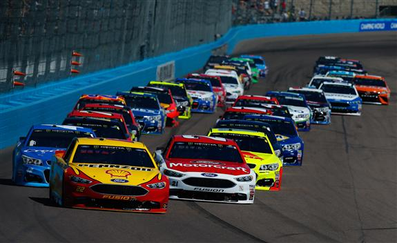 Logano takes the lead. (Sean Gardner/Getty Images