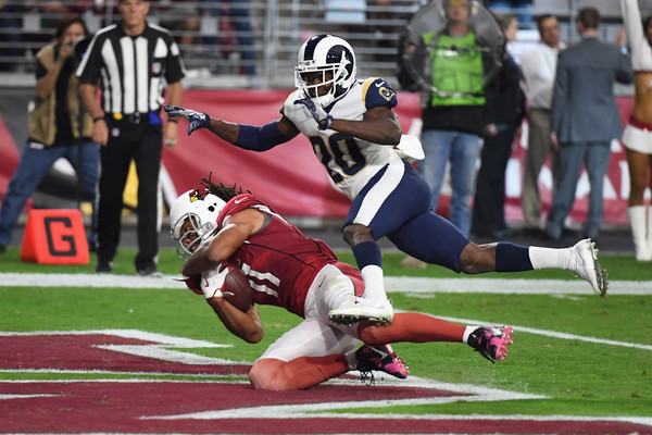 Wide receiver Larry Fitzgerald #11 of the Arizona Cardinals scores a touchdown over free safety Lamarcus Joyner #20 of the Los Angeles Rams. |Source: Norm Hall/Getty Images North America|