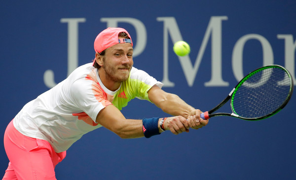 Lucas Pouille reaches for a backhand at the US Open in New York City/Getty Images