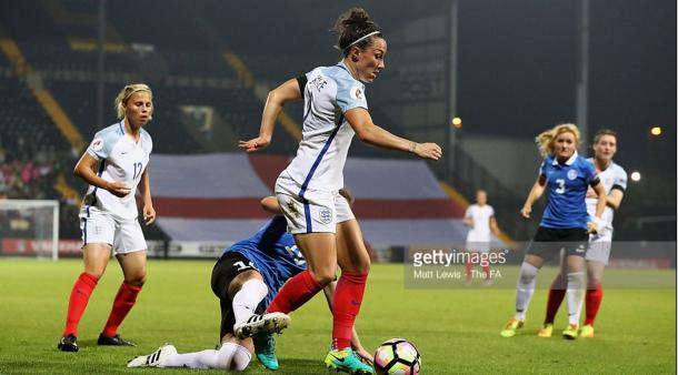 Lucy Bronze battles against an Estonia player | Photo: Matt Lewis - The FA