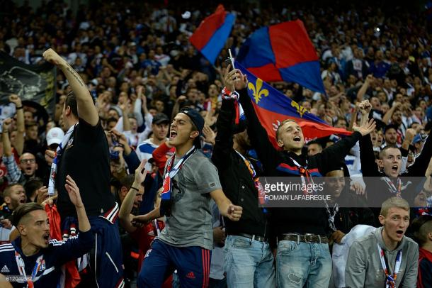Lyon fans show their support during Le Derby. Source | Getty Images.