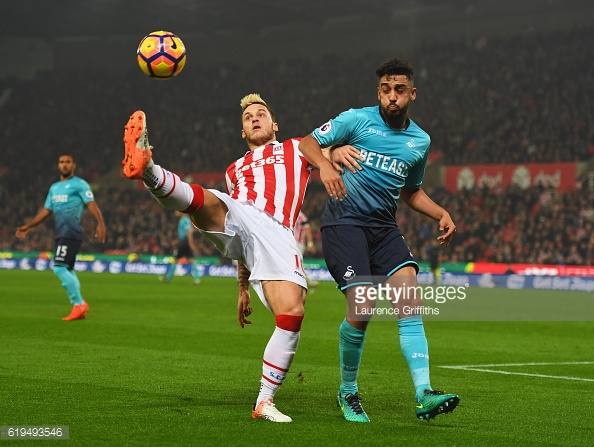 Marko Arnautovic battles with Neil Taylor during the Premier League match between Stoke City and Swansea City. |  Photo: Laurence Griffiths/Getty Images