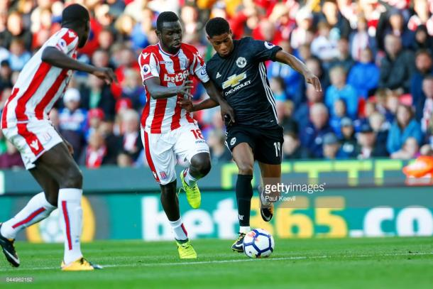 Mame Biram Diouf battles Marcus Rashford for the ball last weekend. Source | Getty Images.