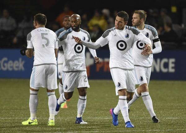 Minnesota's Christain Ramirez celebrates a goal against Portland. (Steve Dykes/Getty Images North America)
