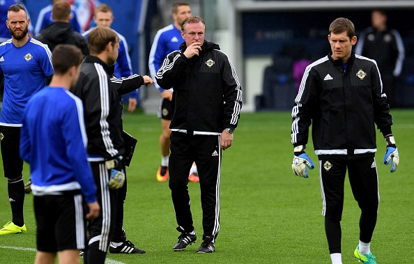 Michael O'Neill was pensive during today's final training session. | Image credit: PATRIK STOLLARZ/AFP/Getty Images