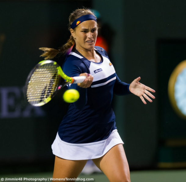 Monica Puig hits a forehand during her third round match against Daria Kasatkina at the 2016 BNP Paribas Open. | Photo: Jimmie48 Photography
