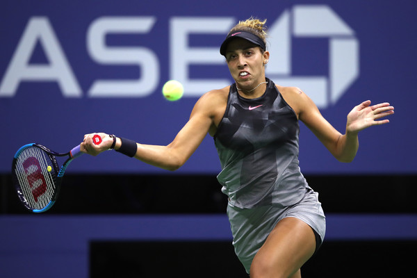 Madison Keys runs to hit a forehand | Photo: Matthew Stockman/Getty Images North America