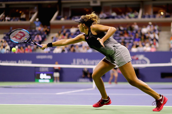 Madison Keys returns a serve | Photo: Abbie Parr/Getty Images North America