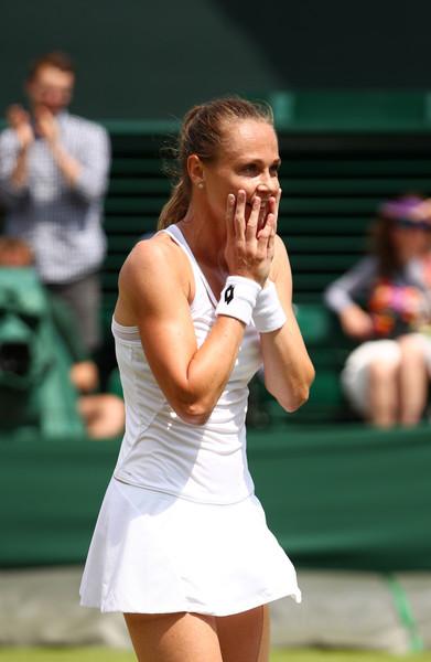 Magdalena Rybarikova celebrates her hard-fought victory | Photo: Clive Brunskill/Getty Images Europe
