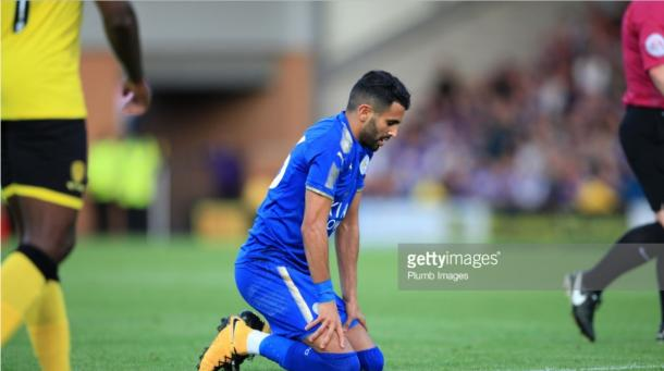 Riyad Mahrez slumps to the floor after a difficult first period | Photo: Getty/ Plumb Images