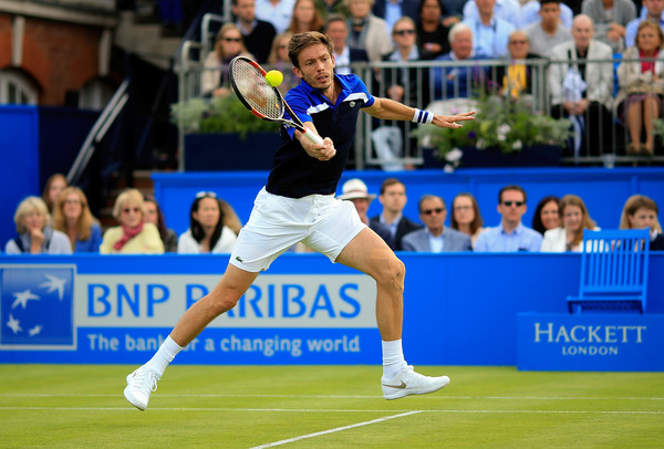 Nicolas Mahut hits a forehand volley. Photo; Ben Hoskins/Getty Images