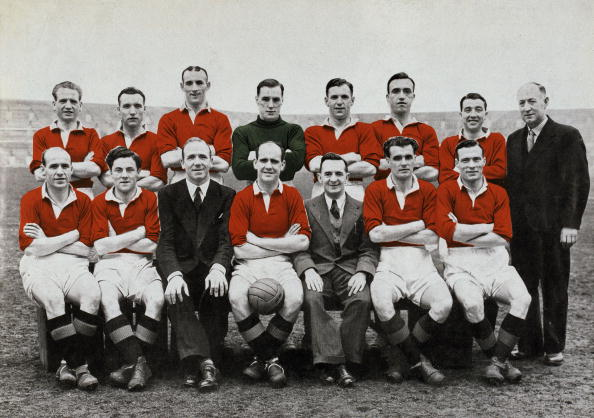 Manchester United winners of the 1948 FA Cup. Back row, left-right, John Warner, John Anderson, Allenby Chilton, John Crompton, Jack Rowley, John Aston, Henry Cockburn, Tom Curry (Trainer), Front row, left-right, James Delaney, John Morris, Matt Busby (Manager), Johnny Carey, Walter Crickmer (Secretary), Stan Pearson, Charlie Mitten (Photo by Popperfoto/Getty Images)